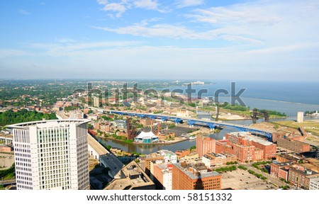 Panoramic aerial view of Cleveland Ohio's Warehouse District, Cuyahoga river, and western shoreline - stock photo