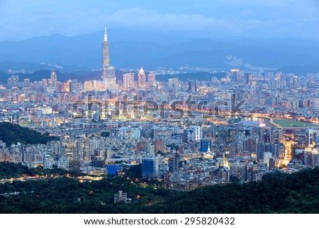 Panoramic aerial view of crowded Taipei City, Taipei 101, XinYi Commercial District, Keelung River and downtown area at moody dusk ~ Taipei City skyline in evening twilight