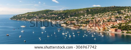 Panoramic aerial view of French Riviera coast at Villefranche-sur-Mer harbour and Cap de Nice with leisure boats anchored at Mediterranean sea - stock photo