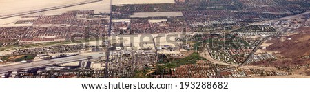 Panoramic aerial view of Palm Springs city sprawl in the California desert - stock photo