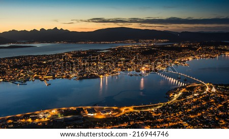 Panoramic aerial view to Tormoso city in northern Norway just after sunset - urban and nature background - stock photo