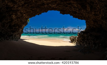 Panoramic amazing view from cave to the tropical beach with azure sea, blue sky and sands beach / Tropical beach Bali / Indonesia  - stock photo