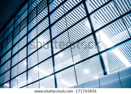 Panoramic and perspective wide angle view to steel gray background of glass high rise building skyscrapers in modern futuristic downtown - stock photo