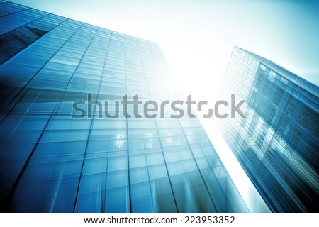 Panoramic and perspective wide angle view to steel light blue background of glass high rise building skyscraper commercial modern city of future. Business concept of success industry tech architecture - stock photo