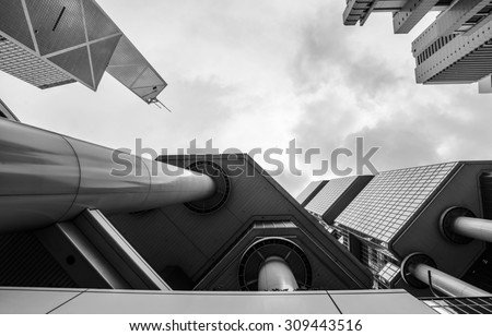 Panoramic and prospective wide angle view to steel black and white of glass high rise building skyscraper, commercial modern city of future Business concept of successful industrial architecture - stock photo