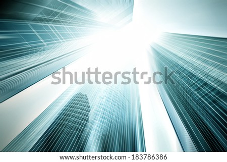 Panoramic and prospective wide angle view to steel light blue background of glass highrise building skyscraper, modern futuristic commercial city Business concept of successful industrial architecture - stock photo