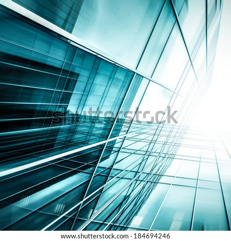 Panoramic and prospective wide angle view to steel light blue background of glass highrise building skyscraper, commercial modern city of future. Business concept of successful industrial architecture - stock photo