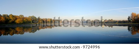 Panoramic autumn view of lake and forest