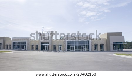 panoramic beige, brown and white strip mall with stone accents - stock photo