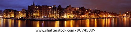 Panoramic city scenic in Amsterdam with the Munt Tower in the Netherlands at sunset - stock photo