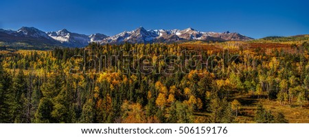 Panoramic Colorado mountain scene at autumn