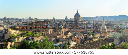 Panoramic colorful view of Rome at sunset. Italy