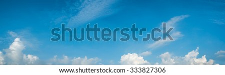 Panoramic composition photo of beautiful blue cloudy sky for background usage. - stock photo