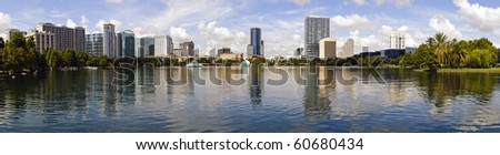 Panoramic created from multiple images of Orlando, Florida skyline as seen from Lake Eola Park - stock photo