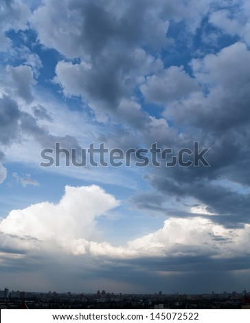 Panoramic dramatic cloudscape in city - stock photo
