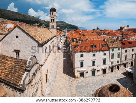 Panoramic Dubrovnik city view with medieval style buildings with red tiled roofs and city square  - stock photo