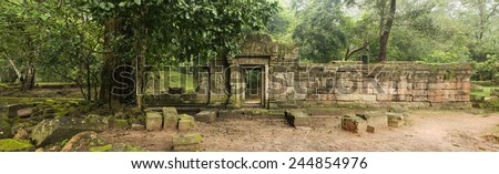 Panoramic image of an old wall and doorway, Baphuon Temple, Angkor Wat, Cambodia - stock photo