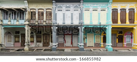 Panoramic image of row of old and new heritage houses in George Town, Penang, Malaysia. - stock photo