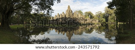 Panoramic image of the Bayon Temple with pool reflection, Angkor Wat, Cambodia - stock photo