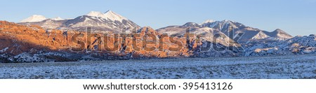 Panoramic image of the LaSal Mountains at winter sunset, just south of Moab, Utah. - stock photo