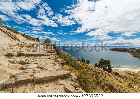 Panoramic Inca trail on Island of the Sun, Titicaca Lake, among the most scenic travel destination in Bolivia. Travel adventures and vacations in the Americas. One person walking in the distance. - stock photo