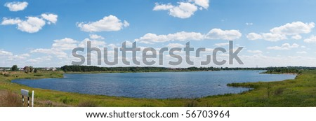 Panoramic lake the sky and clouds - stock photo