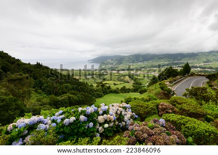 Panoramic landscape in a viewpoint of the island of Sao Miguel. Azores are one of the main tourist destinations in Portugal. This archipelago has amazing tourist attractions. - stock photo