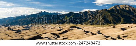 Panoramic landscape of Great Sand Dunes National Park in the Colorado Mountains - stock photo