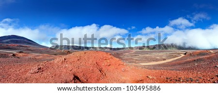 Panoramic landscape of road in volcanic landscape of Plaine des Sables, Reunion Island National Park. - stock photo