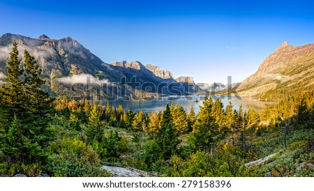 Panoramic landscape view of Glacier NP mountain range and lake, Montana, USA - stock photo