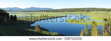 Panoramic landscape view of Yellowstone National Park with Yellowstone river flowing through - stock photo