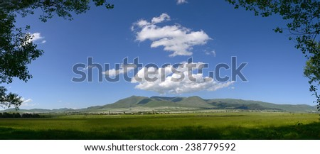 Panoramic landscape with spectacular clouds - stock photo