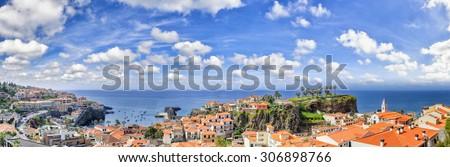 Panoramic landscape with view of Camara de Lobos, small fisherman village on Madeira island - stock photo