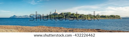 Panoramic light light house port view Port D'Alcudia - stock photo