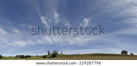 Panoramic New Zealand farmland scene - stock photo