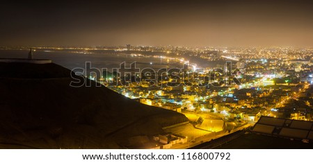 Panoramic night shot of Lima city, Peru - stock photo