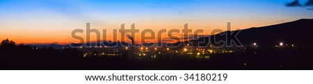Panoramic night view of a factory - stock photo