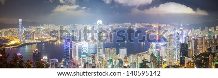 Panoramic night view of Hong Kong from Peak - stock photo