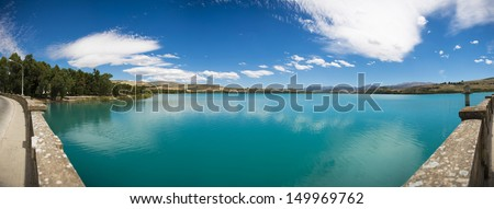 Panoramic of a dam. Blue sky - stock photo