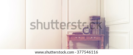 Panoramic of Antique Books and Clock on Old Wooden Table in Corner of Room in Modern Home with White Walls and Decorative Moulding. 3d Rendering. - stock photo