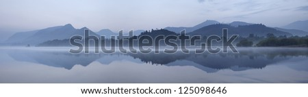 Panoramic of Derwent Water in Cumbria and the hills beyond in the mist.