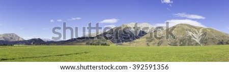 Panoramic of Southern Alps in New Zealand towards Arthurs Pass - stock photo