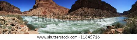 panoramic of the Colorado River flowing through Badger Creek rapid in Marble Canyon, Grand Canyon, Arizona - stock photo