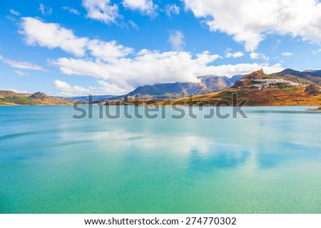Panoramic of Zahara de la Sierra over Guadalete river (forming Zahara reservoir). Typical white town in the province of Cadiz, Spain