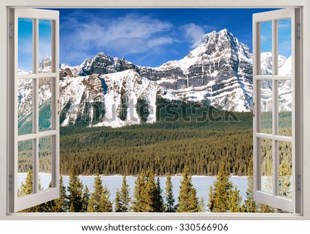 Panoramic open window view to snow peaks of Canadian Rocky Mountains in summer - stock photo