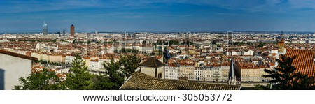 Panoramic overview to Lyon city, orange roofs and new buildings, France - stock photo