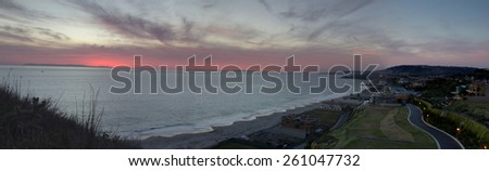 Panoramic / panorama of The Strand Beach in Dana Point, Southern California at sunset / dusk on March 15, 2015 - stock photo