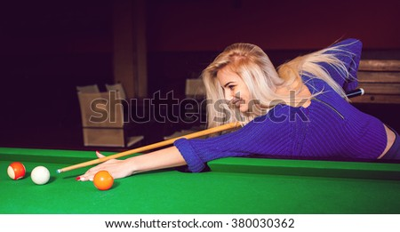 panoramic photo lovely blonde girl playing on the pool table. Billiard sport concept. Pool billiard game. American pool billiard. - stock photo