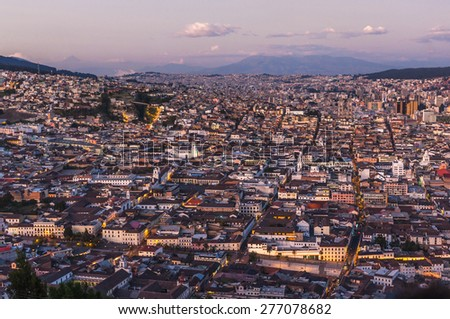 Panoramic photo of Quito capital city at sunset, Ecuador, South America - stock photo