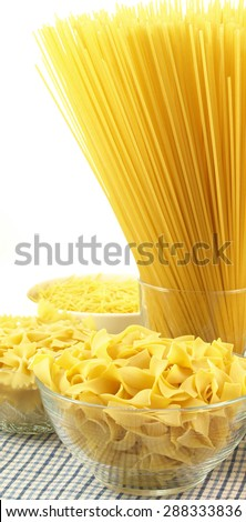 Panoramic photo of raw different pasta in bowls